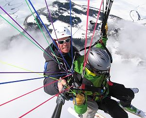 paragliding tandem pilot and passenger
